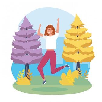 Meisje dat met vrijetijdskleding en pijnbomen springt