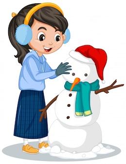 Meisje dat sneeuwman op wit maakt