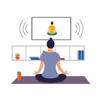 Meisje doet online yoga thuis op tv yoga pose voor het versterken van de favoriete hobby van lichaam en geest