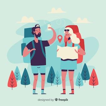 Meisje en jongen die naar de bergen reizen