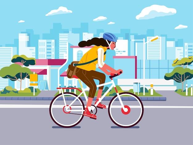 Meisje fietsen op de weg jonge vrouw fietsen naar het werk met veiligheidshelm