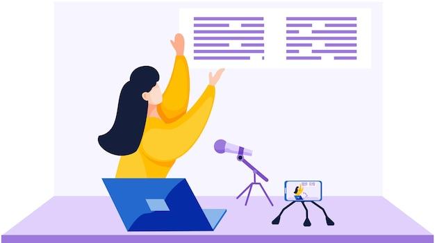 Meisje in een gele trui staat aan de tafel, maakt video-opnamen en leest het bericht op de microfoon