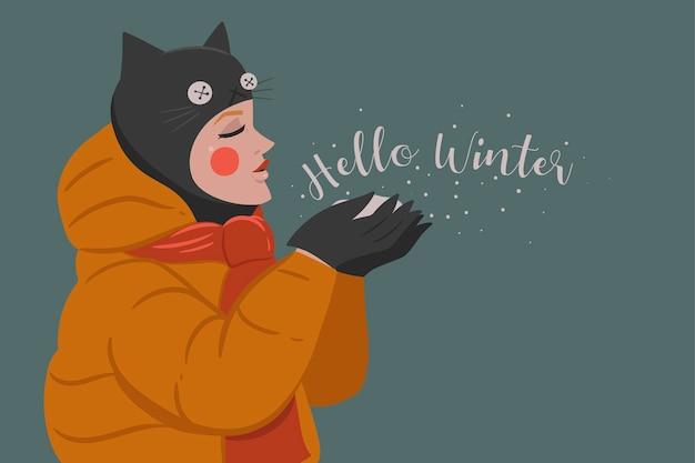 Meisje in een hoed met kattenoren en de inscriptie hallo winter