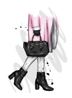 Meisje in mooie schoenen met hakken, een jas en met een stijlvolle tas.