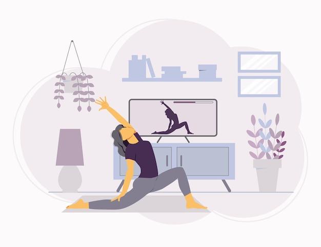 Meisje kijken naar yoga online lessen thuis. yoga en meditatie op afstand beoefenen.