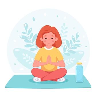 Meisje mediteert in lotushouding gymnastiekyoga en meditatie voor kinderen