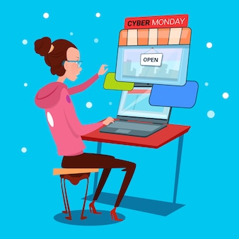 Meisje met behulp van laptop cyber maandag grote verkoop winkelen