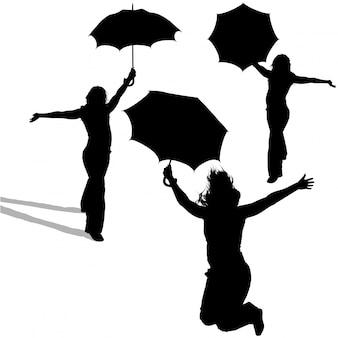 Meisje met paraplu silhouetten