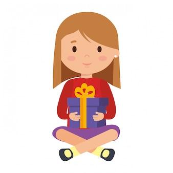 Meisje met winterkleren en cadeau