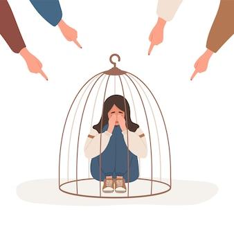 Meisje opgesloten in kooi. vingers wijzen op droevige moslimvrouw.