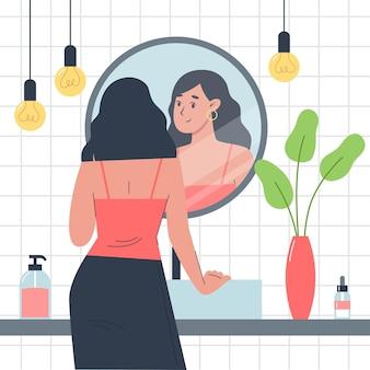 Meisje staat voor een spiegel in de badkamer en kijkt naar zichzelf