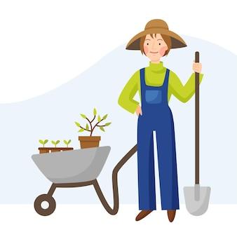 Meisje tuinman in een hoed en overall een boerin staat met een schop