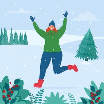 Meisje verheugt zich in de sneeuw. winterpret op sneeuwlandschap.