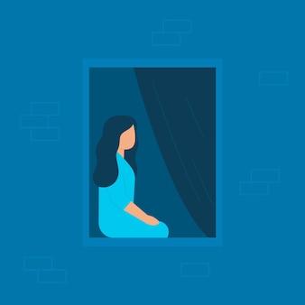Meisje zit thuis en kijkt 's avonds of' s nachts uit het raam eenzame vrouw thuis in quarantaine