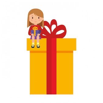 Meisje, zittend in geschenk met winterkleren