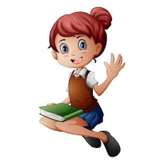 Meisje, zittend met een boek te houden