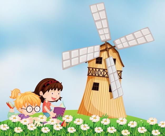 Meisjes die op de heuveltop bij het barnhouse lezen