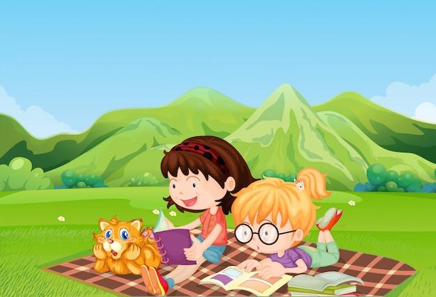 Meisjes die op het veld lezen