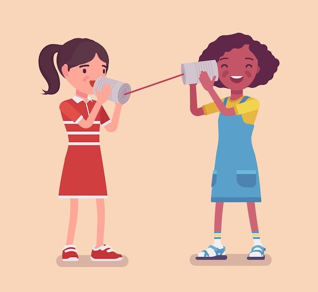 Meisjes die spreken via een blikje telefoon