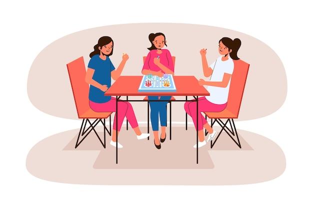 Meisjes die thuis ludo-spel spelen
