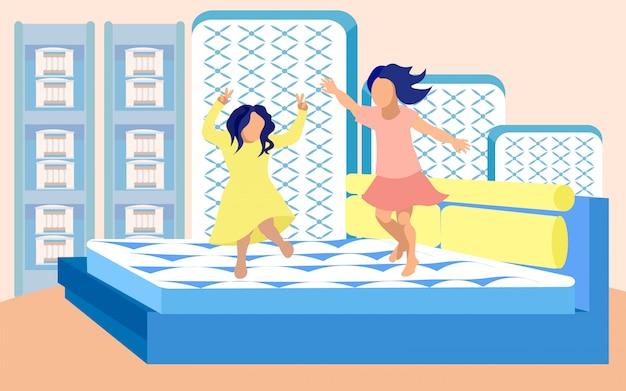 Meisjes gek rond op bed in matrassen winkel