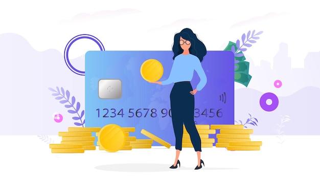 Meisjes houdt een gouden munt. berg munten, creditcard, dollars. het concept van sparen en accumulatie van geld. goed voor presentaties en zakelijke artikelen.