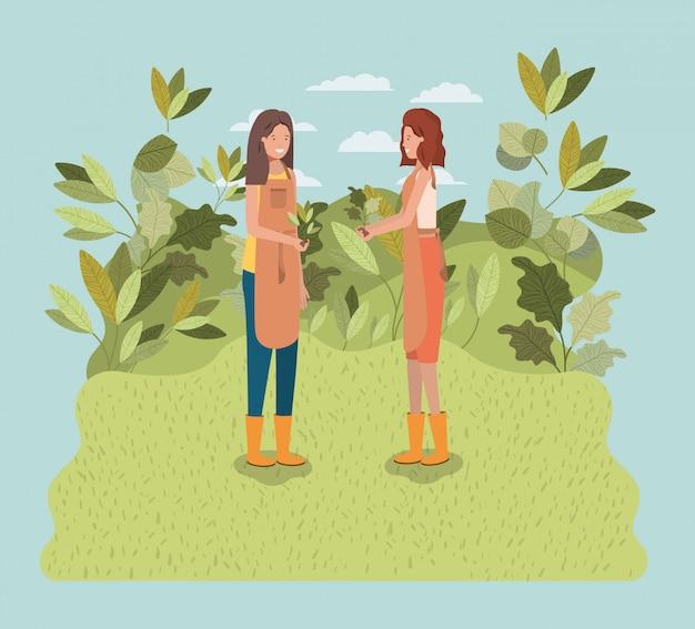 Meisjes planten van bomen in het park