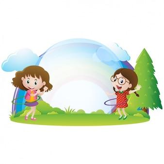 Meisjes spelen op de weide