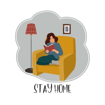 Meisjeszitting als voorzitter en lezing een boek in een flat in quarantaine.