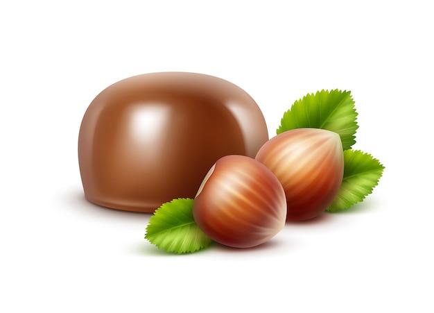 Melkchocoladesuikergoed met hazelnoten op achtergrond