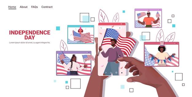 Meng racemensen met amerikaanse vlaggen die vieren, de landingspagina van de onafhankelijkheidsdag van 4 juli