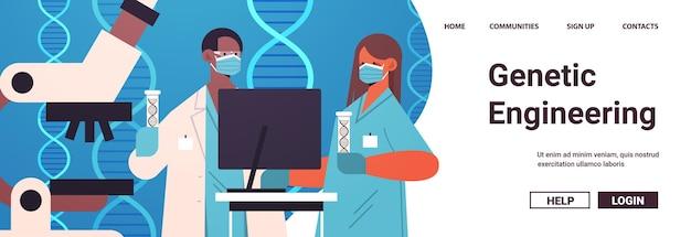 Meng raswetenschappers in maskers die met dna in reageerbuizen werken onderzoekers die experiment maken in laboratorium dna-testen genetische manipulatie diagnose