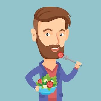 Mens die gezonde plantaardige salade eet.