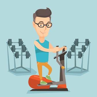 Mens die op elliptische trainer uitoefent.
