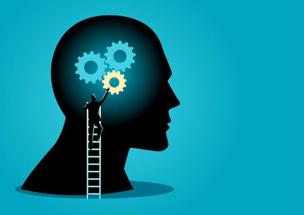 Mens die op ladder toestellen op menselijk hoofd installeert