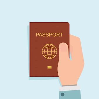 Mens die rood paspoort houdt.