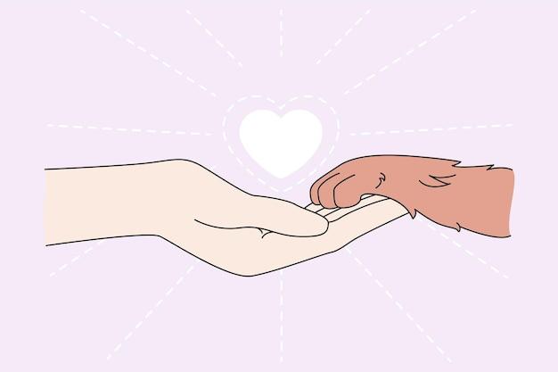 Menselijke hand houd huisdier poot show liefde