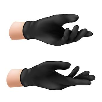 Menselijke hand in een zwarte nitril beschermende handschoen. van een rubberproduct om de huid te beschermen tegen verschillende virussen, microben en bacteriën die op witte achtergrond worden geïsoleerd