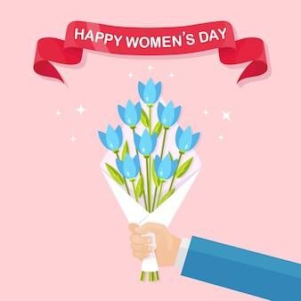 Menselijke hand met boeketten of trossen bloeiende bloemen. internationale vrouwendag.