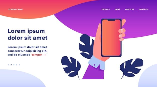 Menselijke hand met mobiele telefoon. persoon met behulp van apps op smartphone platte vectorillustratie. technologie concept websiteontwerp of bestemmingswebpagina