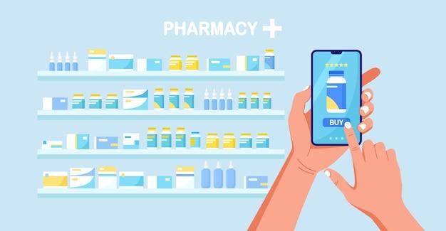 Menselijke hand met mobiele telefoon voor online betaling van medicijnen. online apotheek winkelen. medische hulp, gezondheidszorgconcept.