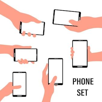 Menselijke hand met smartphone set