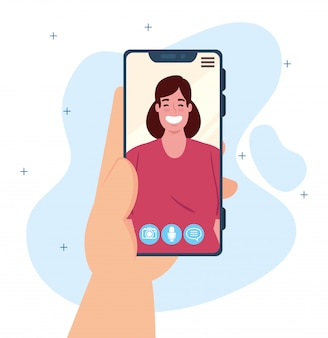 Menselijke hand met smartphone videogesprek op het scherm met jonge vrouw, social media concept