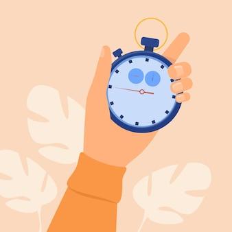 Menselijke hand met stopwatch