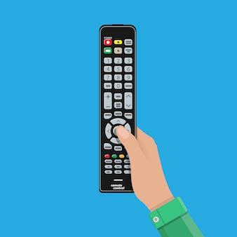 Menselijke hand met zwarte moderne afstandsbediening tv-bediening