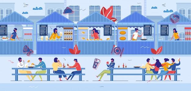 Mensen bezoeken food court voor het kopen van voedsel, fair