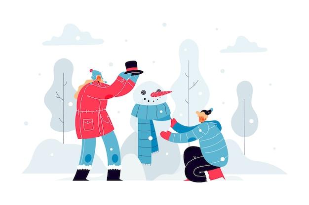 Mensen bouwen buiten een sneeuwpop