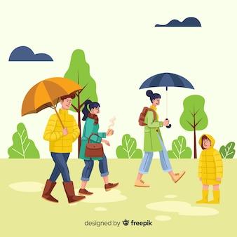 Mensen die een wandeling in de herfst hebben