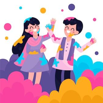 Mensen die holifestival in golven van kleuren vieren