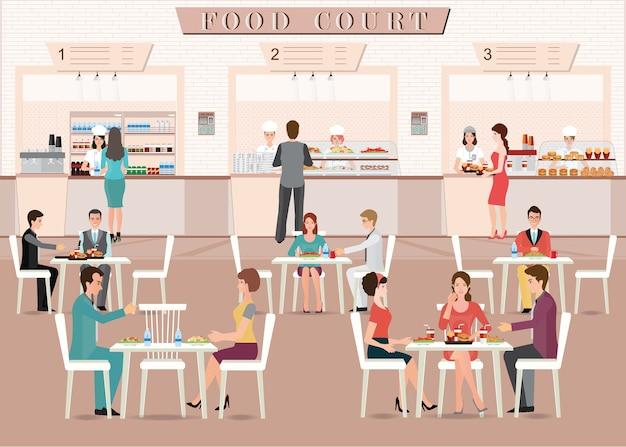 Mensen die in een voedselhof eten in een winkelcomplex.